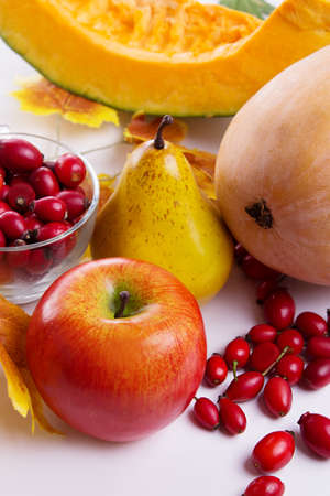 Autumn fruits and vegetables assorted on table photo