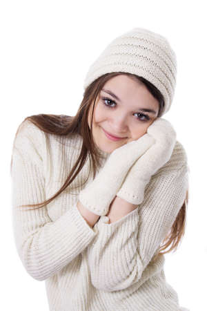 Pretty teenage girl in knitted mitten and hat isolated over white photo