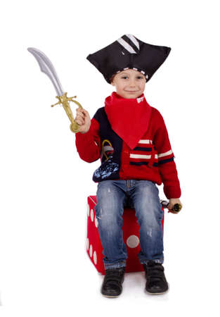 small sword: Small boy dressed like pirate holding toy sword over white