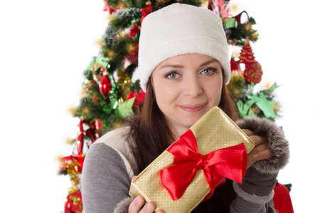 Smiling woman in fur hat and mitten holding Christmas present Stock Photo - 24210112