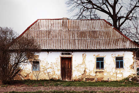 Abandoned old house on dramatic landscape photo
