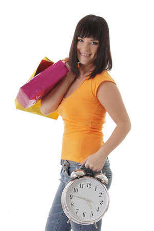 begs: Smiling girl with shopping begs and clock over white, shopping time concept