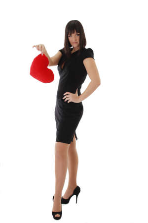 Elegant woman in dress and heels holding heart over white photo