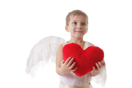 Cute smiling cupid with heart in a hands, isolated on white photo