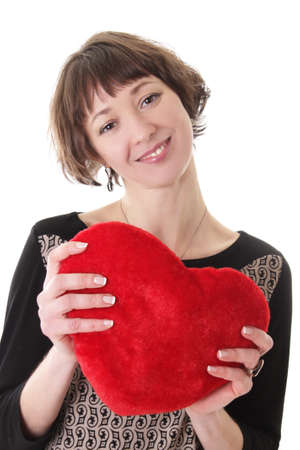 Smiling woman with red plush heart over white photo