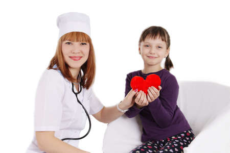 Female doctor and little girl holding plush heart over white photo