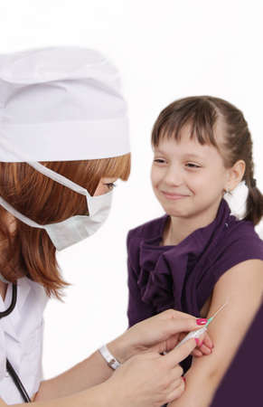 vaccinating: Woman doctor vaccinating girl in hand over white