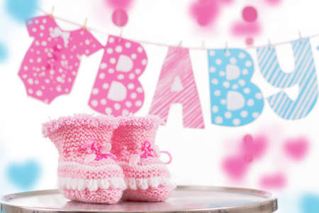 Cute baby element with word baby and pink bootees over white photo
