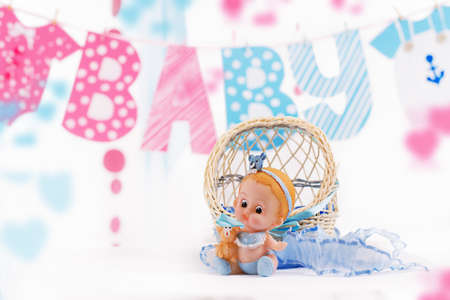 Cute baby elements with word baby and blue toy over white photo
