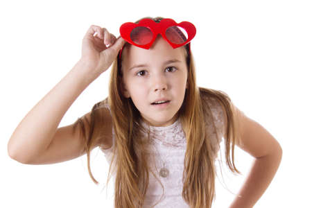 Looking-up surprised girl with funny glasses heart-shaped isolated on white photo