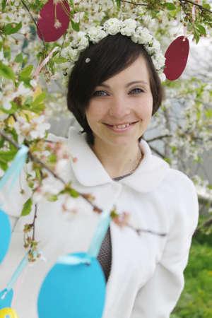 Sensual woman with wreath among spring garden Stock Photo - 28080964