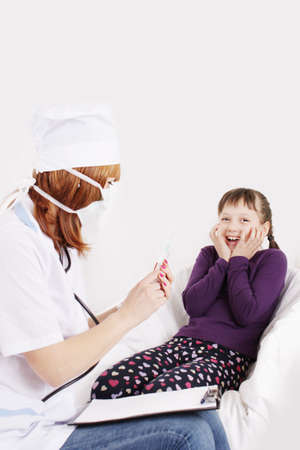 Doctor with syringe needle and girl scared of injections photo