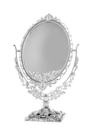 Antique silver mirror isolated on white background photo