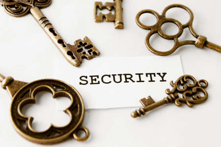 Some vintage keys with word security over white photo