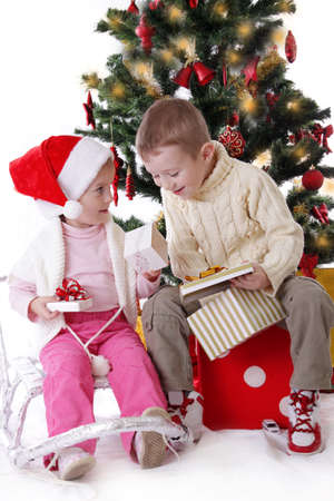 Sister and brother showing Christmas presents to each other photo