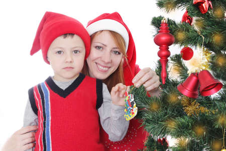santa helper: Happy mother and little boy as Santa helper decorating Christmas tree over white