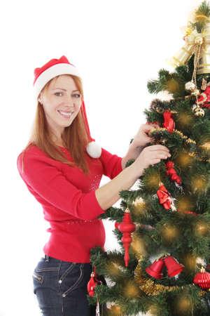 decorating christmas tree: Smiling woman decorating Christmas tree over white Stock Photo