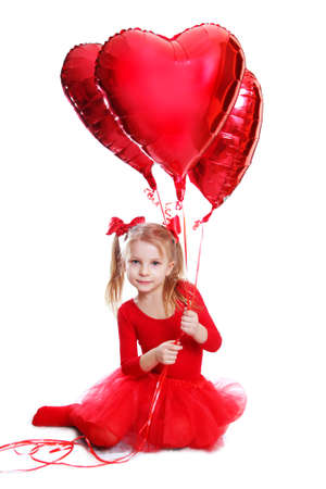 Ballerina like dressed girl sitting with red heart shaped balloons over white photo