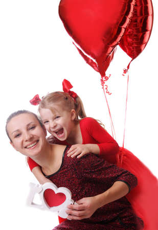Happy mother and daughter with red word love and balloons over white photo