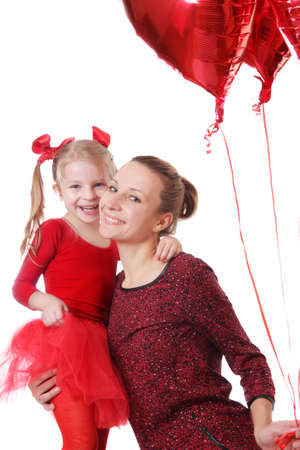 Happy daughter and mother with red balloons over white photo