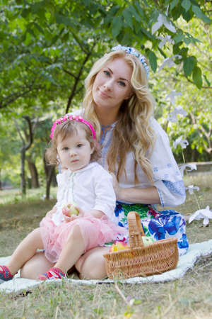 ethnology: Mother and baby girl in Moldova national costume outdoor Stock Photo