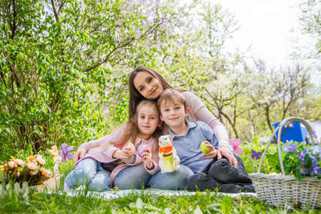 family and friends: Mother and two children with Easter decor