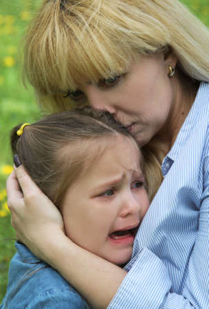 comforting: Mother comforting crying daughter outdoor Stock Photo