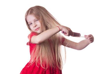 tangled: Upset girl combing tangled long hair on white Stock Photo