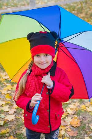 rainbow umbrella: Girl with rainbow umbrella in autumn