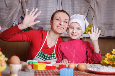 Mother and daughter having fun with flour photo