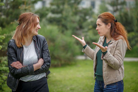 Mother and daughter communicating emotionally outdoor Stock Photo