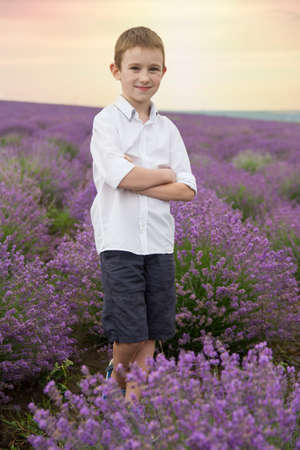 Cute smiling boy in avender field sunset photo