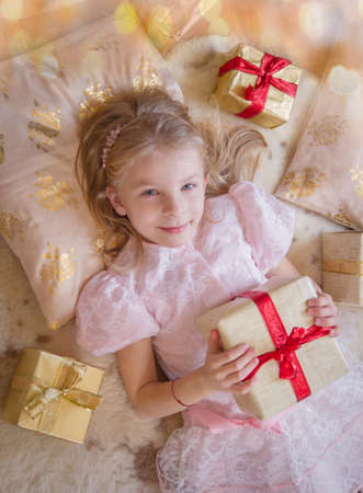 Top view of smiling female kid with lots of presents Stock Photo