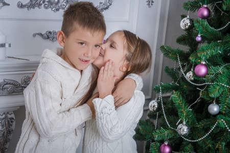 Girl whispered to her brother what to ask for Santa Claus