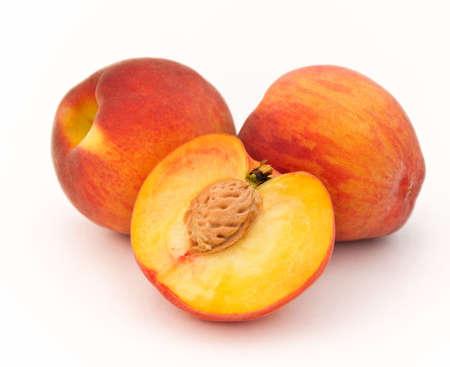 Peaches on a white background. Stock Photo