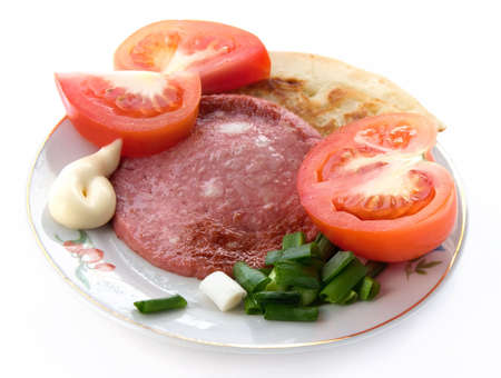 Sausage with vegetables on a white background.