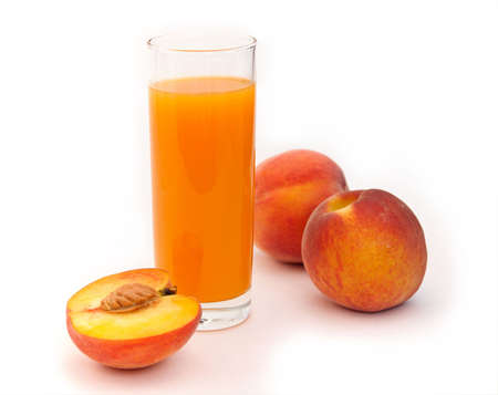 Peaches and juice on a white background.