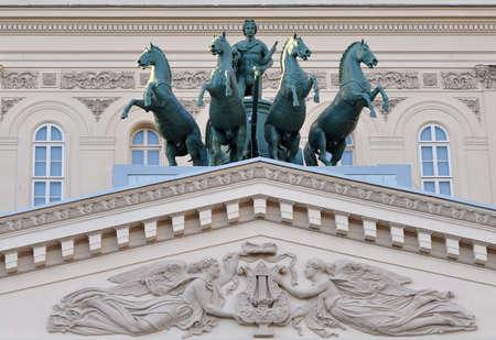 Sculptural composition above the entrance. Stock Photo