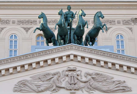 Sculptural composition above the entrance. Stock Photo
