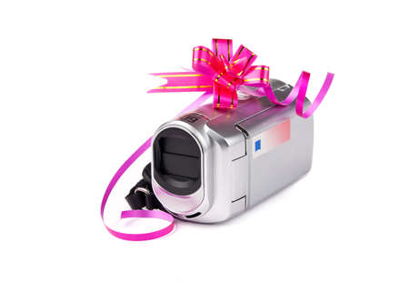 Video camera into the gift against the white background. Stock Photo