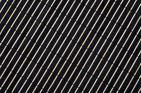 Black bamboo diagonal background into the strip.
