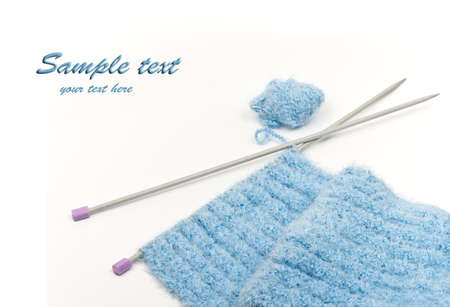 Binding and knitting needle against the white background. Stock Photo