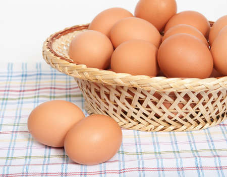 Eggs in the basket on the table.
