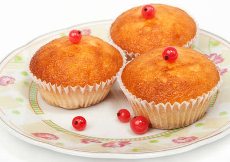 Three cakes with the red currant.