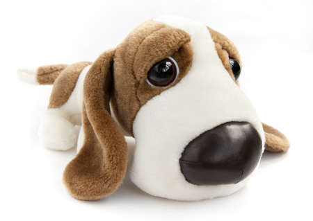 Toy dog against the white background.