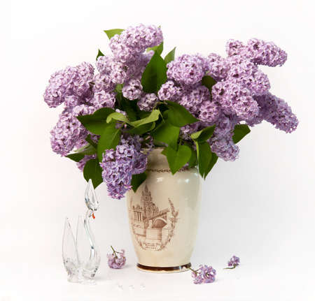 Bouquet of lilac and the crystal swan.