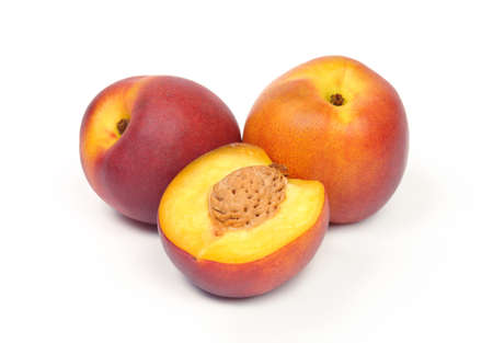 Ripe peaches against the white background.