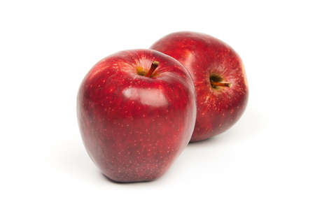 Red apples against the white background.