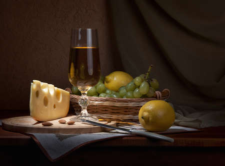 Wine, fruits and cheese to supper. Stock Photo
