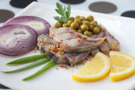 Herring with the green peas and the lemon